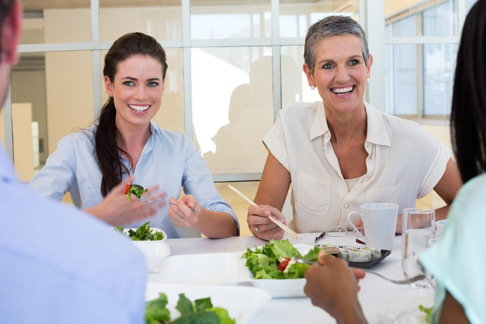 Women Eating salad Lunch