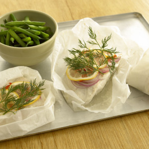 Fish parcels wrapped in lemon, dill and onion