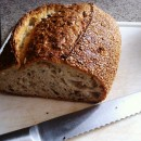 Seeded bread being cut